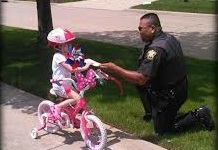 Officers Again Giving 'Tickets' to Kids Wearing Helmets